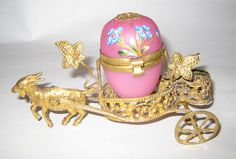 A Dainty Pink Opaline Glass Egg and Goat Cart.