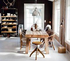 black walls, white floors, wood table