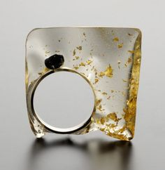 ring - resin and gold leaf  : transparent art form www.clerkbase.com/transparency-Catalina Brenesdefined.