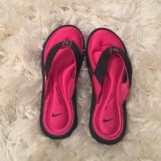 Brand New Nike flip flops! Nike flip flops- never worn! Got them as a gift and they didn't fit! Size 8! Black with pink padding ( Nike comfort footbed) Nike Shoes Sandals