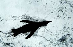 A penguin swims through a basin at the zoo in Hanover, Germany on April 6.