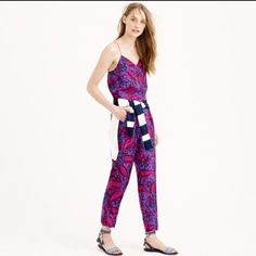 """*final price* JCrew midnight floral jumpsuit This summery jumpsuit hits all the S's: silky, strappy and sexy, thanks to the skinny T-strap at the back. The silk was specially printed with a floral we found on a vintage jacquard swatch and recolored in-house. The finished result: an easy, polished piece that lets you do one-and-done dressing in 60 seconds flat.  Silk. Side zip. Slant pockets. Lined. Dry clean. Import. 26"""" inseam. Wore only once! J. Crew Pants Jumpsuits & Rompers"""