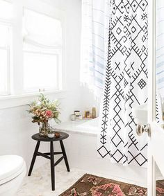 like the shower curtain...black and white theme could be achieved with accessories if we want to keep the design more timeless/neutral