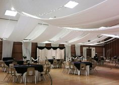 Ceiling hung wires draped with fabric/streamers and fairy lights (example 2)