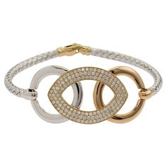 Ladies hand-assembled circular 18ct two-tone gold rope style bracelet, polished finish with parrot clasp. #Jacobs #graysonline #auction #diamond