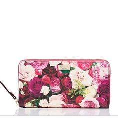 Kate Spade Grant Street Floral Needa In EUC, used for several months, simply adorable.  Please note the minor scratches on the interior zipper pull, other than that I do not see any other visible signs of wear.  trades/PP.  Reasonable offers kate spade Bags Wallets