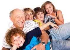 Stock image of 'Happy family having fun together lying in studio, posing'