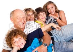 Stock image of 'Happy family having fun together lying in studio, posing'