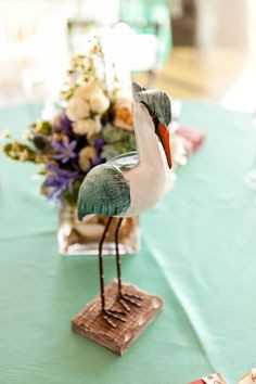 Rustic wooden cranes are the perfect centerpiece for this beach wedding. Wedding Planner: MB Wedding Design and Events.