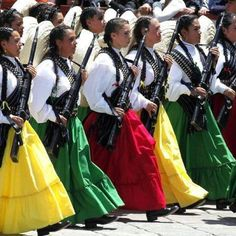 Adelitas photo from Mexico's bicentennial celebration 2 yrs ago  http://darkroom.baltimoresun.com/2012/05/cinco-de-mayo-en-todo-el-pais-around-the-country/female-soldiers-dressed-in-traditional-clothing-march-during-a-military-parade-in-culmination-of-bicentennial-celebrations-in-mexico-city/