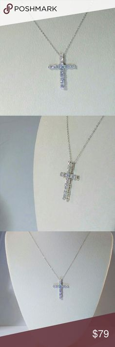 """JUST IN 🌸 Simulated Diamond Cross Necklace The 4.2 carat tw sparkling simulated diamonds are made with Swarovski Gemstones™ cubic zirconia. There are ten Swarovski CZs that are as brilliant as diamonds. The excellent platinum over sterling silver cross pendant is 1-1/4"""" long and 7/8"""" wide. It is set on a 20"""" platinum over sterling silver chain with a spring clasp closure. New. Measurements and weights are approximate. Photos may be enlarged to show detail. Jewelry Necklaces"""