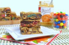 Monster Blonde Brownies - monster cookie blonde brownie bars filled with biscoff and M  #biscoffrecipes #monstercookies  http://www.insidebrucrewlife.com