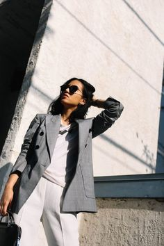 LA Blogger Tania Sarin in Century City wearing Allbirds and featuring a blazer and white trouser pants