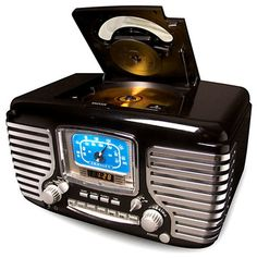 [Black Corsair AM/FM Radio/Alarm Clock] I love the chrome-heavy retro styling and  dynamic stereo speakers! Crosley's alarm clock radio with CD Player is not only functional but fabulous. Styled out like a 1950s automobile, this vintage icon has streamlined sophistication with lots of functionality. Modern conveniences incorporate an AM/FM radio, programmable CD player with 20-track memory, dual alarms that can be set and used independently. Wake up to CD, radio or alarm buzzer.