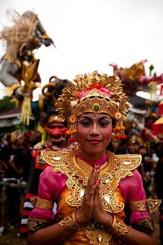 A Balinese woman in a ceremonial dress at the Pecatu Nyepi parade near Uluwatu in Bali.