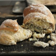 One large loaf, with a chunk removed revealing the small squares of pear and crumbled Stilton cheese.