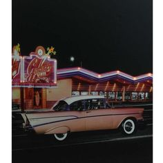 "LED Lighted Coral Pink 1957 Chevy Bel Air in Front of a Diner Canvas Wall Art 23.5"""" x 19.75"""""