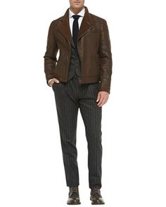 Leather Shearling Moto Jacket, Slim-Fit Button-Down Shirt, Flannel Notch-Lapel Vest, Flannel Chalk-Stripe Trousers & Cashmere-Knit Tie by Brunello Cucinelli at Bergdorf Goodman.