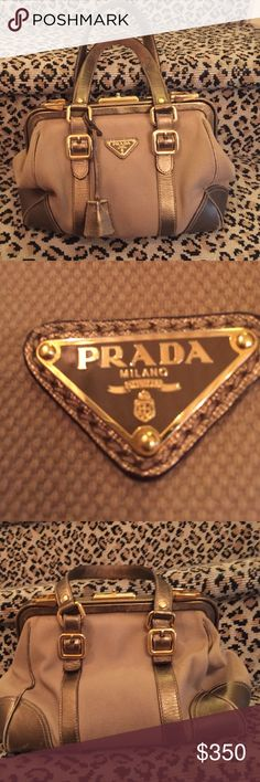 """Authentic Prada Handbag. Camel/Tan/Gold Camel Colored Canvas with Leather Lines that Accent its Individuality. I bought on Posh and have something very similar. Listing for same price I paid a couple weeks ago. Has some wear but very durable, timeless, and rare. Handles drop about 7"""". Any other questions, I'd be happy to answer. Prada Bags"""