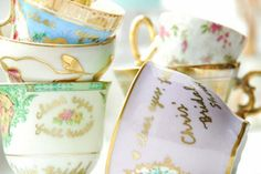 """Vintage tea cups with personal notes"" - This is a cute idea, it would be so fun to have a Alice in Wonderland themed bridal shower. I would wear an Alice themed dress and black bow headband to mine, so fun."
