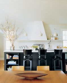 A marble-topped island and three Thonet bentwood stools are comfortable for quick meals or homework.