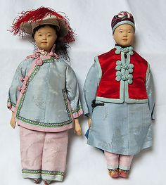 "A pair of children in silk. 9"". The hat doesn't belong  to the girl. Everything else is correct about their clothing."
