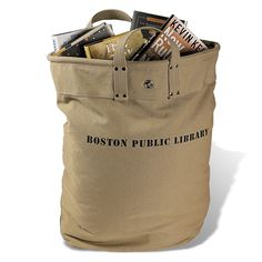 Boston Public Library Delivery Tote Bag: More than 100 years ago, the workers of the Boston Public Library figured out that the best way to ferry books between their branches was in this deep, heavy-duty, easily grasped bag -- one in each hand, to balance the load. A portion of each sale benefits the Boston Public Library, America's only public library that is also a presidential library, and where its 28 branches still shuttle books in these bags every day.