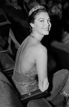 Ava Gardner smiles for the cameras at the premiere of The Barefoot Contessa, 1954