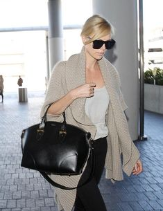 74b0e3176d Charlize Theron Photos - Charlize Theron is seen at LAX on July 12