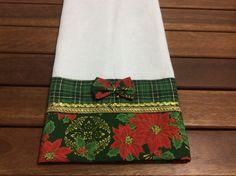 Pano de prato em tecico de algodão na cor branco , com detalhes em tecido de algodão .  Medida 50x70cm