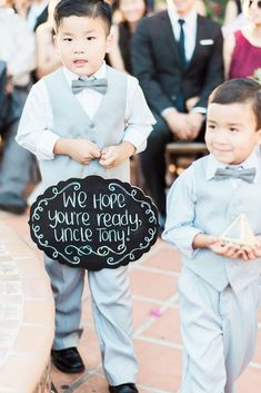 ring bearer littlele boy with sign etherandsmith
