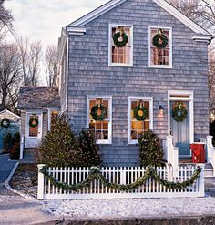 Dressed with classic wreaths on every window and door,