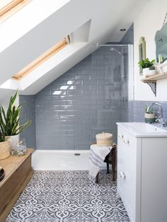 Real home: an Edwardian terrace with a loft conversion gets a boho makeover & Real. The post Real home: an Edwardian terrace with a loft conversion gets a boho makeover appeared first on Claire Layton Interiors. Small Attic Bathroom, Loft Bathroom, Upstairs Bathrooms, Small Shower Room, Bathroom Mirrors, Skylight In Bathroom, Grey Floor Tiles Bathroom, Bathroom Subway Tiles, Sloped Ceiling Bathroom