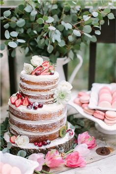 The greenery on this cake table stands out more than an arrangement of pink flowers would have, and without competing against the pretty cake.