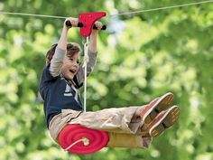 Kids' ziplines are really a blast! Our ziplines for kids are perfect for backyard fun. Ziplines hang between trees for tons of outdoor play that kids love. Backyard Swings, Backyard Playground, Backyard For Kids, Diy For Kids, Cool Kids, Backyard Zipline, Backyard Ideas, Kids Fun, Backyard Toys