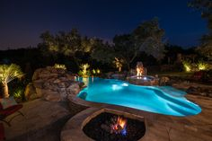 Fire pit, spa, huge rock waterfall with grotto, and a beach entry. This pool has everything!