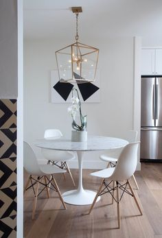 Eiffel Chairs and a Saarinen Table make dinners taste better. Always. @studiomatsalla you are so chic! xoxo