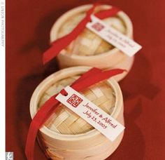 Each guest received a tiny bamboo steamer box containing two red-foil wrapped…