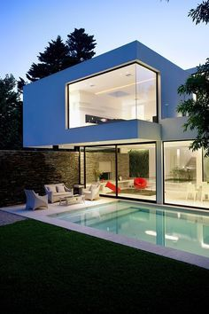 This modern two-storey single family residence designed by Andres Remy Arquitecto in 2010 is located in Buenos Aires, Argentina
