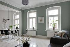 The green-grey color of the living room wall in this apartment is such an eye-catcher. I like that the same color comes back in the pillows in the bedroom as well. The kitchen has a very simple design, yet the … Continue reading → Dining Room Feature Wall, Living Room Inspiration, Design Inspiration, White Floorboards, Nordic Bedroom, Gravity Home, Nordic Design, House Design, Interior Design