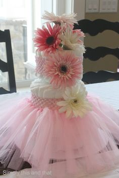 Use a headband tutu set to top off a diaper cake and be used for newborn photography and monthly milestones pictures -- ongoing, practical, and sentimental gift!
