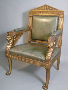 Empire gilded winged lion elbow chair, pale green leather upholstery, 107cm high. **available to hire** (Stock code;- CHAC10008)
