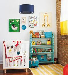Love the rug, book shelf, artwork.  Primary color scheme.