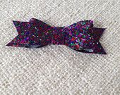 The Original Glitter Bow - Available in many colors this sparkly darling will add just the right amount of glitter to your everyday look.  Available as a headband or clip!