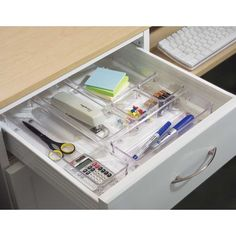 Tackle the junk drawer with the Drawer Bins in Clear - available in four sizes - clear finish makes it easy to fins contents - non slip rubber feet