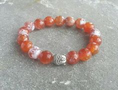 Check out this item in my Etsy shop https://www.etsy.com/uk/listing/251751676/agate-buddha-bracelet-fire-agate