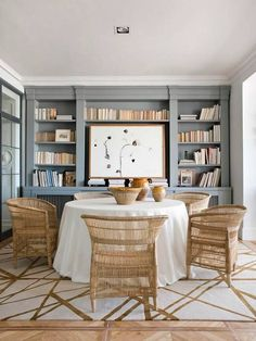 Woven Rattan Dining Chairs + Gray built ins in the Dining Room + Round Table Dining Room Blue, Dining Room Design, Dining Rooms, Beach Dining Room, Fireplace In Dining Room, Dining Area, Dining Room Office, Bookshelves Built In, Built Ins