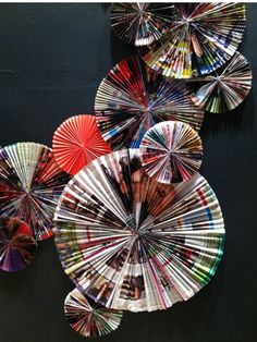 J. Crew window display - pleated paper medallions made with magazine pages