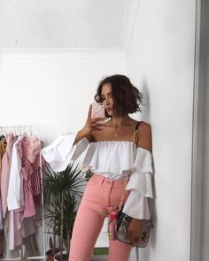 White off the shoulder ruffle top and pink panks