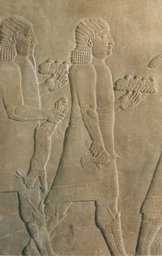 Servants back from the royal hunt with a hare and small birds.    Relief from Ashurbanipal's palace at Nineveh 7th century BC.